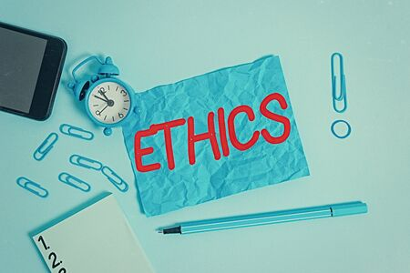 Conceptual hand writing showing Ethics. Concept meaning the moral philosophy or code of morals practiced by an individual Alarm clock notepad smartphone band marker colored background