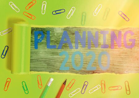Writing note showing Planning 2020. Business concept for process of making plans for something next year Standard-Bild