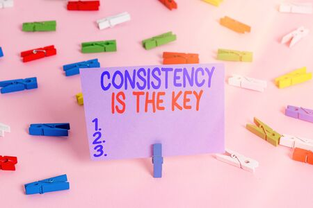Handwriting text writing Consistency Is The Key. Conceptual photo by Breaking Bad Habits and Forming Good Ones Colored clothespin papers empty reminder pink floor background office pin