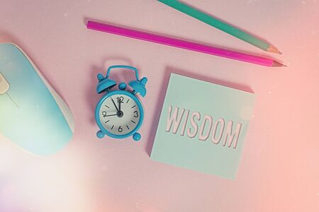 Text sign showing Wisdom. Business photo showcasing quality having experience knowledge and good judgement something Alarm clock wakeup blank notepad mouse markers colored background