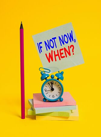 Conceptual hand writing showing If Not Now When Question. Concept meaning start acting from this moment do not hesitate Alarm clock sticky note notepads pencil colored background