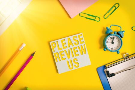 Conceptual hand writing showing Please Review Us. Concept meaning situation or system is formal examination by showing authority Flat lay above copy space on the white crumpled paper