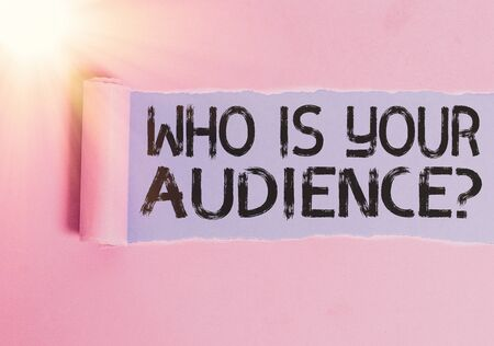 Writing note showing Who Is Your Audience Question. Business concept for who is watching or listening to it