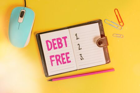 Writing note showing Debt Free. Business concept for does not owning any money to any individual or companies Leather locked diary striped sheets marker mouse colored background Stok Fotoğraf