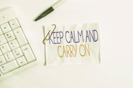 Word writing text Keep Calm And Carry On. Business photo showcasing slogan calling for persistence face of challenge White pc keyboard with empty note paper above white background