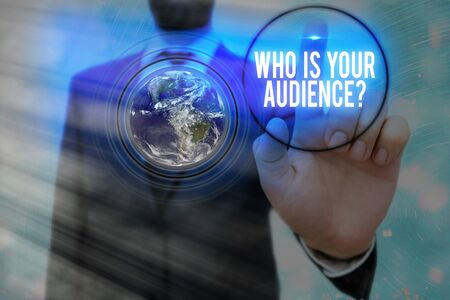 Writing note showing Who Is Your Audience Question. Business concept for who is watching or listening to Foto de archivo
