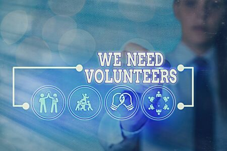 Writing note showing We Need Volunteers. Business concept for someone who does work without being paid for it