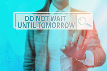 Text sign showing Do Not Wait Until Tomorrow. Business photo showcasing needed to do it right away Urgent Better do now Foto de archivo