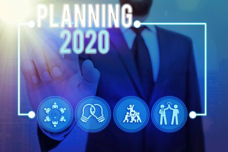 Conceptual hand writing showing Planning 2020. Concept meaning process of making plans for something next year Standard-Bild