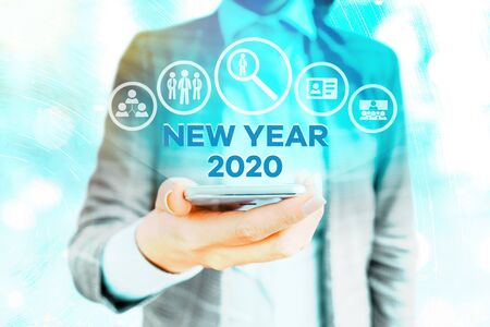 Text sign showing New Year 2020. Business photo showcasing Greeting Celebrating Holiday Fresh Start Best wishes Standard-Bild