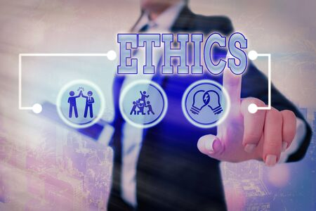 Conceptual hand writing showing Ethics. Concept meaning the moral philosophy or code of morals practiced by an individual