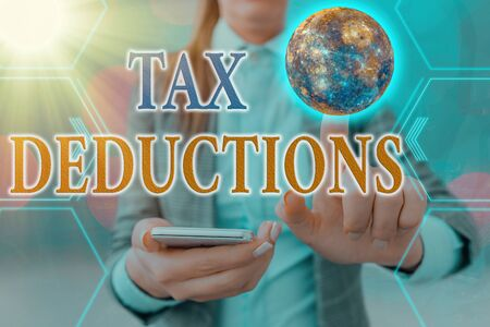 Handwriting text Tax Deductions. Conceptual photo reduction income that is able to be taxed of expenses