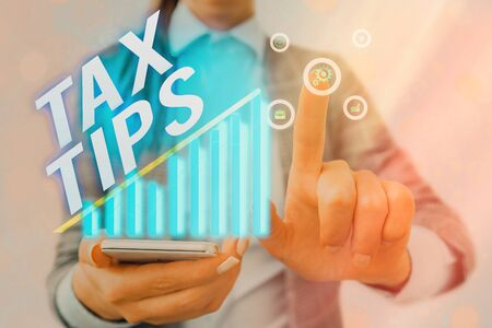 Word writing text Tax Tips. Business photo showcasing compulsory contribution to state revenue levied by government