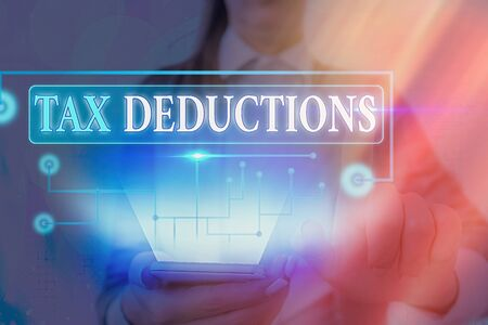 Text sign showing Tax Deductions. Business photo text reduction income that is able to be taxed of expenses Imagens
