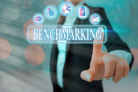 Conceptual hand writing showing Benchmarking. Concept meaning evaluate something by comparison with standard or scores Standard-Bild