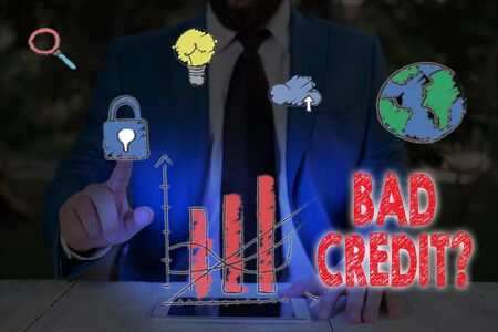 Writing note showing Bad Creditquestion. Business concept for inabilityof an individual to repay a debt on time and in full