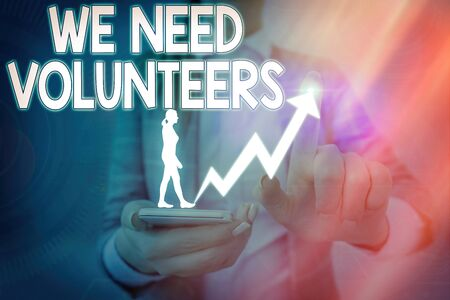 Handwriting text We Need Volunteers. Conceptual photo someone who does work without being paid for it Imagens