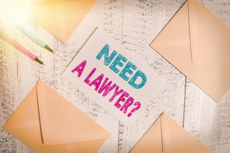 Writing note showing Need A Lawyer Question. Business concept for asking someone who need a legal issues and disputes Envelopes highlighters ruled paper sheet wooden vintage background