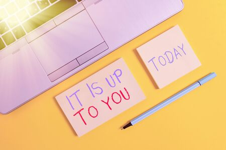 Text sign showing It Is Up To You. Business photo text Used to tell an individual that they are the one to decide Trendy silver open laptop square sticky notepads marker colored background