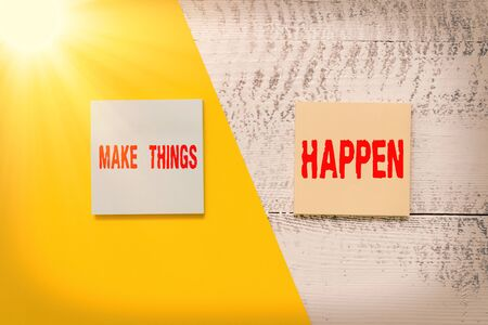 Text sign showing Make Things Happen. Business photo showcasing you will have to make hard efforts in order to achieve it Two multicolor blank notepads colored paper sheet retro wooden background