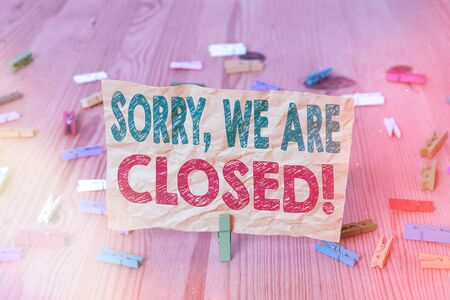 Conceptual hand writing showing Sorry, We Are Closed. Concept meaning apologize for shutting off business for specific time