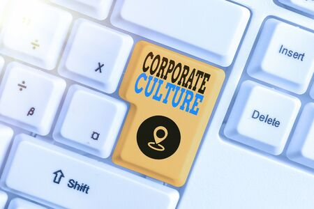 Writing note showing Corporate Culture. Business concept for pervasive values and attitudes that characterize a company Фото со стока