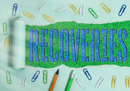 Conceptual hand writing showing Recoveries. Concept meaning process of regaining possession or control of something lost