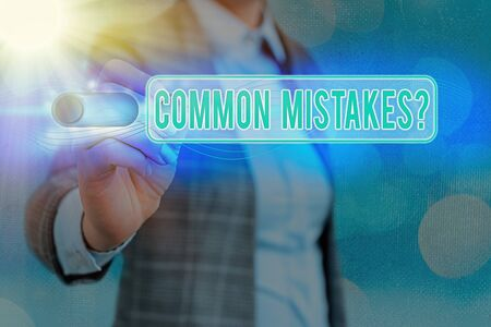 Writing note showing Common Mistakes Question. Business concept for repeat act or judgement misguided making something wrong