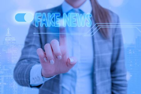 Word writing text Fake News. Business photo showcasing false information publish under the guise of being authentic news
