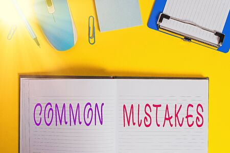 Writing note showing Common Mistakes. Business concept for actions that are often used interchangeably with error Clipboard sheet striped notepad mouse pencil note colored background Фото со стока