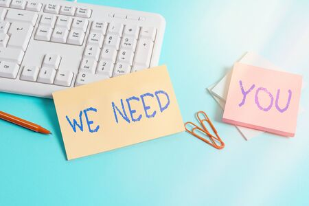 Writing note showing We Need You. Business concept for asking someone to work together for certain job or target Paper blue keyboard office study notebook chart numbers memo