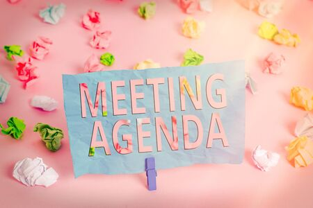 Word writing text Meeting Agenda. Business photo showcasing items that participants hope to accomplish at a meeting Colored crumpled papers empty reminder pink floor background clothespin