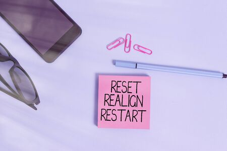 Writing note showing Reset Realign Restart. Business concept for Life audit will help you put things in perspectives Eyeglasses colored sticky note smartphone cell pen pastel background