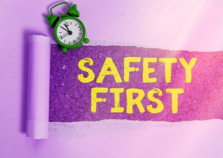 Writing note showing Safety First. Business concept for used to say that the most important thing is to be safe