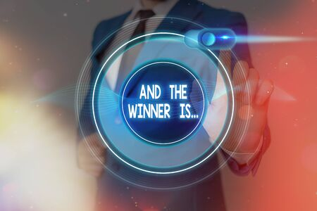 Word writing text And The Winner Is. Business photo showcasing announcing an individual or thing that wins something
