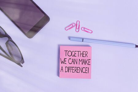 Writing note showing Together We Can Make A Difference. Business concept for be very important some way in like team or group Eyeglasses colored sticky note smartphone cell pen pastel background
