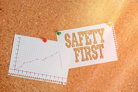 Conceptual hand writing showing Safety First. Concept meaning used to say that the most important thing is to be safe Corkboard size paper thumbtack sheet billboard notice board