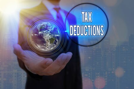 Writing note showing Tax Deductions. Business concept for an amount or cost that subtracted from someone s is income