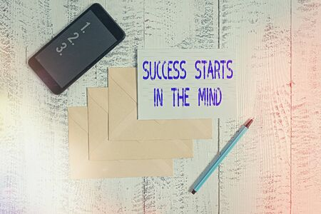 Conceptual hand writing showing Success Starts In The Mind. Concept meaning set your mind to positivity it can go a long way Envelopes marker ruled paper smartphone wooden background Stok Fotoğraf