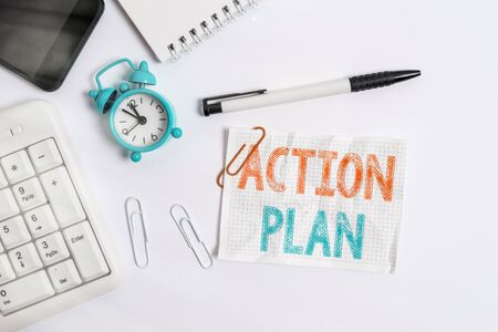 Conceptual hand writing showing Action Plan. Concept meaning detailed plan outlining actions needed to reach goals or vision Flat lay above computer mobile phone clock pencil and note paper Stock Photo