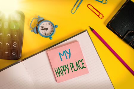 Text sign showing My Happy Place. Business photo showcasing something nice has happened or they feel satisfied with life Notebook wallet calculator clips pencil note alarm clock color background