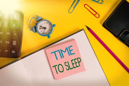 Text sign showing Time To Sleep. Business photo showcasing a natural period of slumber or to be in state of inactivity Notebook wallet calculator clips pencil note alarm clock color background