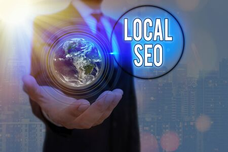 Writing note showing Local Seo. Business concept for helps businesses promote products and services to local customers Banque d'images