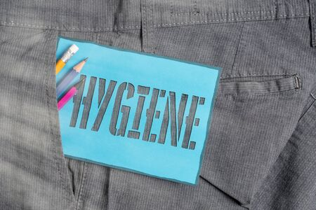Conceptual hand writing showing Hygiene. Concept meaning study of science of the establishment and maintenance of health Writing equipment and blue note paper in pocket of trousers