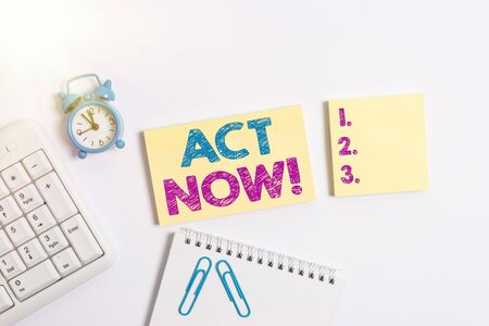 Handwriting text Act Now. Conceptual photo fulfil the function or serve the purpose of Take action Do something Blank paper with copy space on the table with clock and pc keyboard