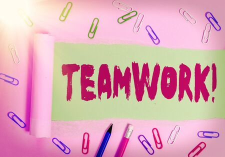 Writing note showing Teamwork. Business concept for combined action of group especially when effective and efficient Фото со стока