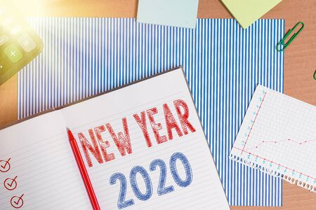 Text sign showing New Year 2020. Business photo text Greeting Celebrating Holiday Fresh Start Best wishes Striped paperboard notebook cardboard office study supplies chart paper Stok Fotoğraf