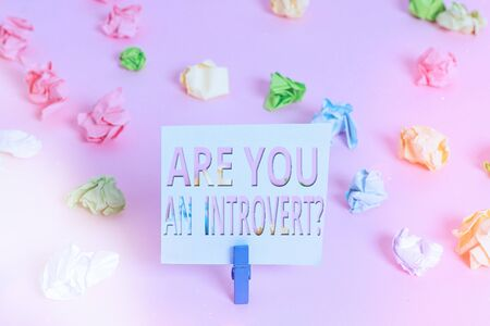 Word writing text Are You An Introvertquestion. Business photo showcasing an individual who tends to turn inward mentally Colored crumpled papers empty reminder pink floor background clothespin