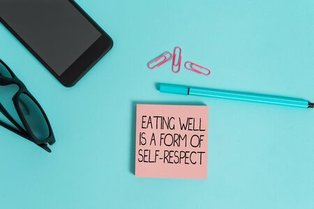 Writing note showing Eating Well Is A Form Of Self Respect. Business concept for a quote of promoting healthy lifestyle Eyeglasses colored sticky note smartphone cell pen pastel background