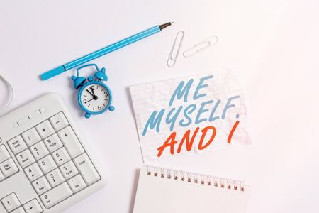 Word writing text Me Myself And I. Business photo showcasing used by speaker to refer to herself as the object of a verb Copy space on empty note paper with clock and pencil on the table 写真素材